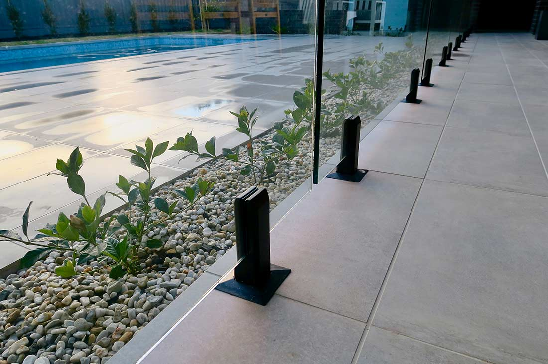 Frameless Glass Pool Fencing With Matte Black Spigots
